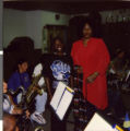Series of two Polaroid photographs of Marzette Lewis with the Charles I. West Middle School Band