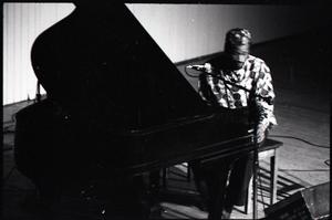 Taj Mahal in concert at Northfield, Mass.: Taj Mahal playing garnd piano