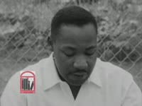 WSB-TV newsfilm clip of Dr. Martin Luther King, Jr. speaking to reporters at an outdoor press conference about violence the night before and the civil rights movement's nonviolent response in Albany, Georgia, 1962 July 25