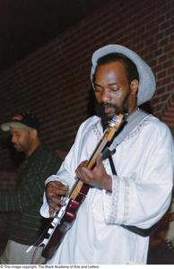 [Close-up of unknown guitarist leaning back while playing with his band] Reggae in the Caribbean