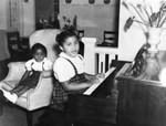 Jackie Rucker playing the piano