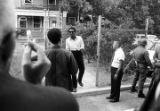 Stokely Carmichael walking down a sidewalk toward Rap Brown after Carmichael's release from prison in Prattville, Alabama.