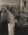 Dr. George Washington Carver in his laboratory on the campus of Tuskegee Institute.