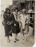 Three members of the Northeasterners, Inc., Edith Scott, Louise Swain, and Helene Corbin on Seventh Avenue in Harlem