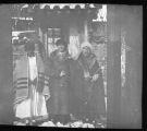Fr. John E. Morris, MM, standing outdoors with two Korean men, Korea, ca. 1920-1940