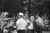 Public safety commissioner Bull Connor speaking with other police officers during a civil rights demonstration at Kelly Ingram Park in Birmingham, Alabama.