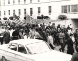 Martin Luther King, Jr., and others marching beside St. Margaret's Hospital on South Jackson Street in Montgomery, Alabama, headed to the county courthouse on Washington Avenue.