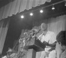 "Man, possibly Floyd McKissick, speaking to an audience in an auditorium during the ""March Against Fear"" through Mississippi, begun by James Meredith."