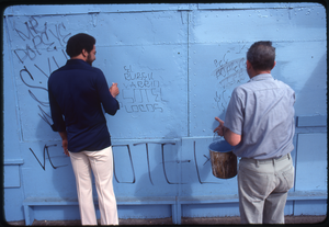 Bill Withers: Withers next to a man cleaning graffiti