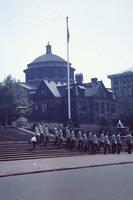 Garrison-capped men on the steps of Columbia University (N.Y.) library