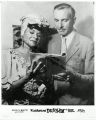 Katherine Dunham and John Pratt reviewing a booklet (duplicate)