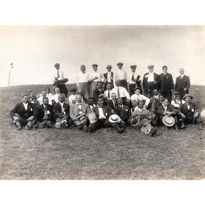 Thirty-six men sitting on a hill