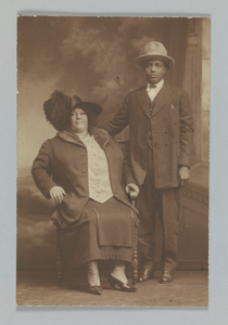 Thumbnail for Photographic print of a woman sitting and a man standing
