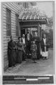 Fr. Sauret with some of his Christians at the door of the mission at Omata, Japan, 1914
