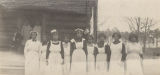 Young African American women standing in front of a school building in rural Jefferson County, Alabama.