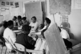 Women seated at a table during an adult education class at the Ash Creek Center in Hayneville, Alabama.