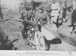Both working for the Y.M.C.A.; Mr. Kelly and his colored driver at work during the last German offensive