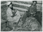 Compton, Negro sharecropper and his wife stripping and grading tobacco. He has a Negro landlord who lives in Mebane, part of a very prosperous Negro settlement, region of North Carolina. September 1939