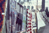 Quilts made by the Clinton Quilting Bee hanging at the Black Belt Folk Roots Festival in Eutaw, Alabama.
