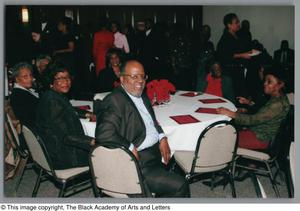 Guests attending Christmas Kwanzaa soiree Christmas/Kwanzaa Soiree