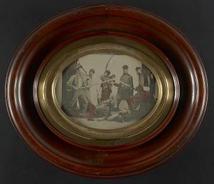 [Seven unidentified soldiers in Union uniforms reenacting a battle scene]