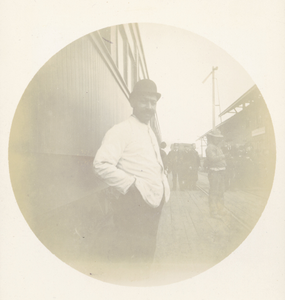 Railroad Employee on Train Platform II, ca. 1893.