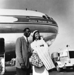 Nat King Cole and woman at airplane
