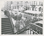 View of two busloads of Catholic school children arriving for class at St. Charles Borromeo Church, on West 142nd Street, in Harlem, New York City, circa late 1940s