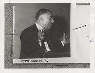 Mississippi State Sovereignty Commission photograph of a profile view of Daniel E. Byrd standing at a wooden podium with the palms of his hands extended, New Orleans, Louisiana, 1950s