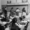 Children solving arithmetic problems on the blackboard in a classroom at Nazareth Catholic Mission in Montgomery, Alabama.