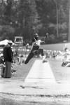 Carl Lewis completing a broad jump, Los Angeles, 1982