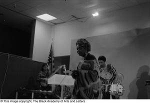 [Photograph of unidentified woman and the band #2] Conference on Black Women in the Arts