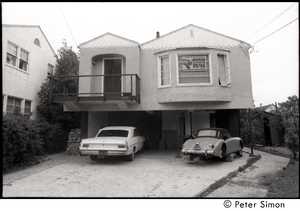 House, probably in Berkeley, with Black Panther sign in the window: 'Defend the Black Community -- New for Congress, Seal for state assembly'