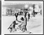California National Guardsmen take up positions along a now-quiet street in the Watts section ...