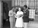 Ruth Washington and Johnnie Cochran reading a publication, Los Angeles, 1983
