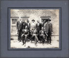11 men, standing and seated