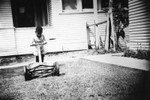 Young boy with a lawnmower