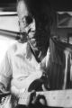 "James """"Son"""" Thomas: Leland, Miss. Thomas playing guitar. Rene Bourdolet seated (JTP 31-78-5 #1667)"