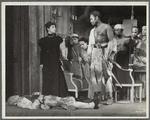 Rex Ingram, shirtless, with dead man