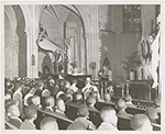 Priest delivering sermon during a religious service held at St. Charles Borromeo Church, in Harlem, New York City, circa late 1940s