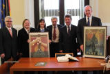 "Doug Berry and Burkley Allen of Sister Cities of Nashville present commemorative ""Spirit of Nashville"" flood relief posters to Dr. Lutz Trümper, mayor of Magdeburg, Germany, Nashville's sister city, in October of 2010"
