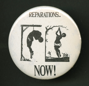"Pinback button which reads ""Reparations.. Now!"""