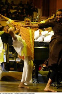 Performers dancing on stage