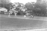 Men at second base during a game played by teams of an amateur baseball league in Montgomery, Alabama.