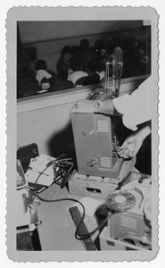 Photograph of a man operating a film projector for school children, Manchester, Georgia, 1953