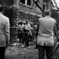 Police officers and fire fighters in the debris outside 16th Street Baptist Church in Birmingham, Alabama, after the building was bombed.