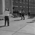 James Hood entering a building for class at the University of Alabama.
