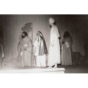 Four actors perform on stage.