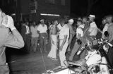 Young African American man confronting another man in front of J. D.'s Grocery after the bombing of the Gaston Motel in Birmingham, Alabama.