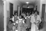 """Children in the group """"Buds of Promise"""" from Mt. Zion AME Zion Church in Montgomery, Alabama, walking through St. Jude Catholic Hospital in Montgomery, Alabama."""